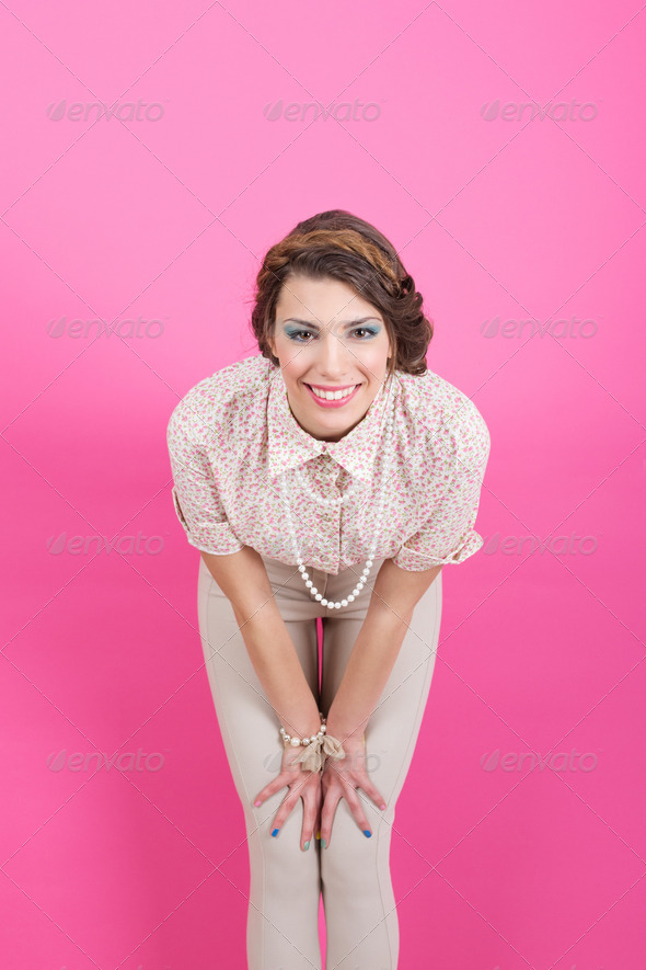 Gorgeous retro girl on pink background - Stock Photo - Images
