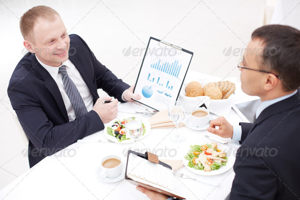 Discussing paper at lunch - Stock Photo - Images