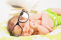 Cute baby boy with eyeglasses and books - PhotoDune Item for Sale