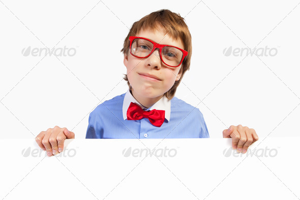School boy in red glasses holding white square - Stock Photo - Images