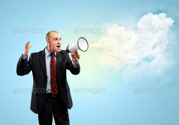 Businessman with megaphone - Stock Photo - Images