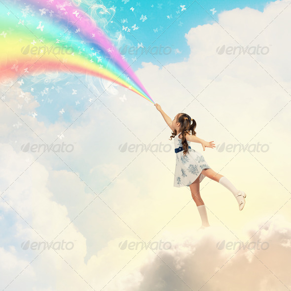 Little girl drawing rainbow - Stock Photo - Images