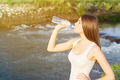 Tired young woman drinking water - PhotoDune Item for Sale