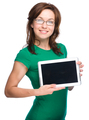 Young cheerful woman is showing blank tablet - PhotoDune Item for Sale