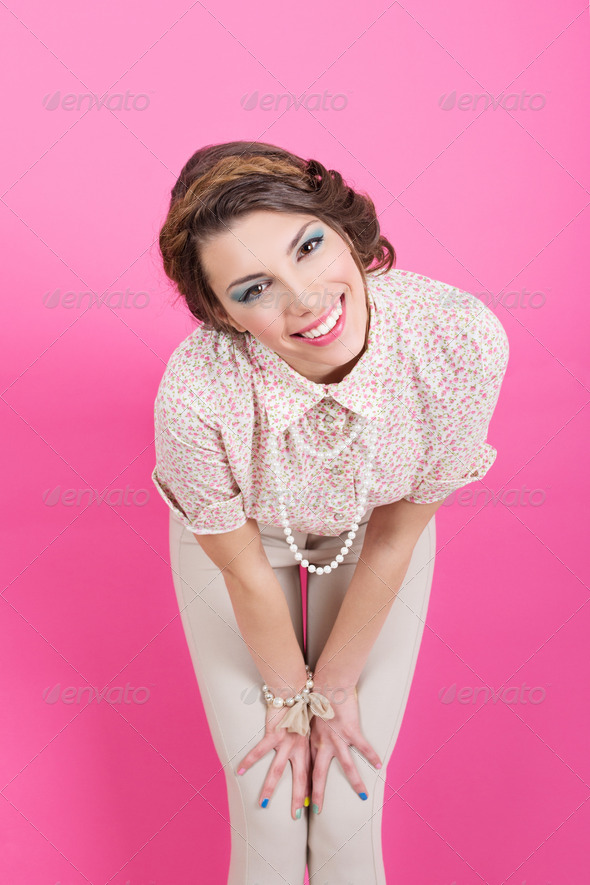 Cute pin-up retro young woman smiling - Stock Photo - Images