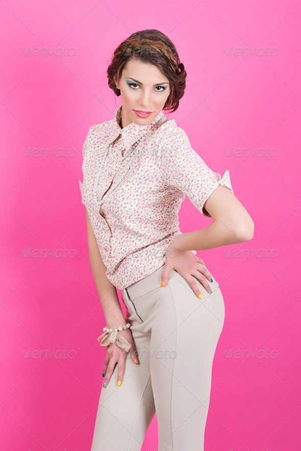 Sexy retro styled woman on pink background - Stock Photo - Images