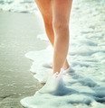 Girl walking on the beach - PhotoDune Item for Sale