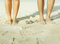 mother and father legs with small baby shoes - PhotoDune Item for Sale