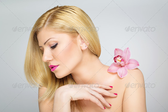 Beautiful young blonde woman wearing sensual floral scent - Stock Photo - Images