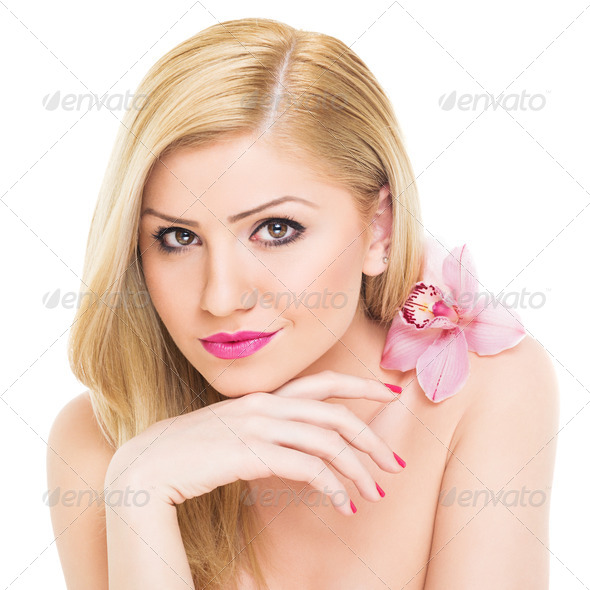Confident young woman with orchid flower - Stock Photo - Images
