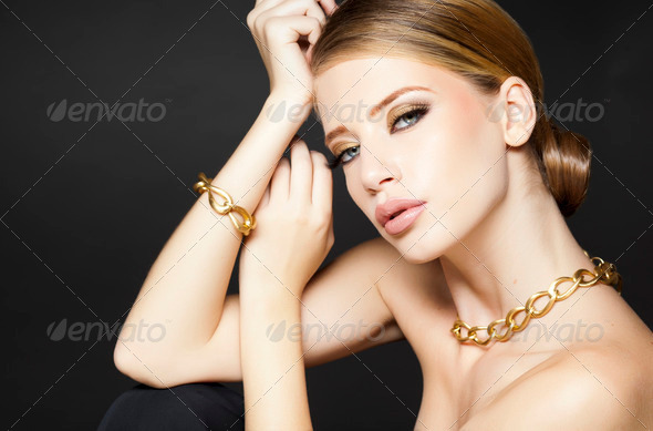 gold jewelry on beautiful woman model posing glamorous - Stock Photo - Images