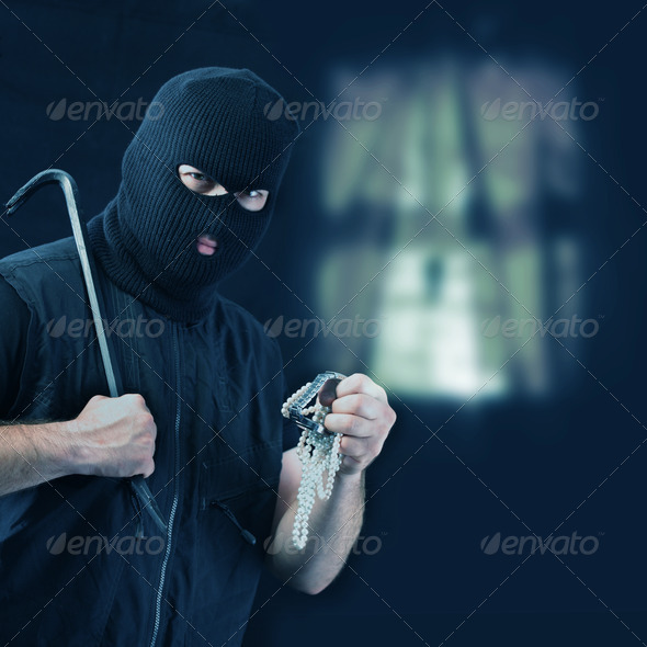 Masked thief stealing jewelry - Stock Photo - Images