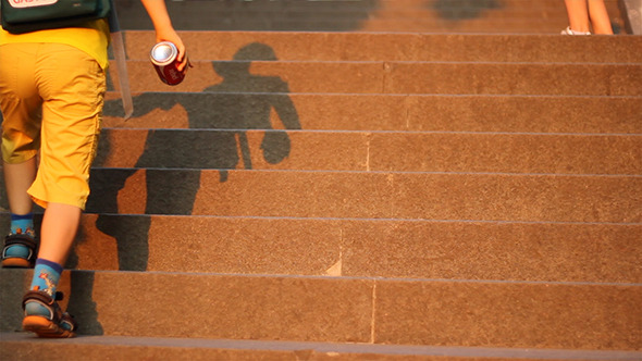 Kid Playing with Shaddow on Stairs