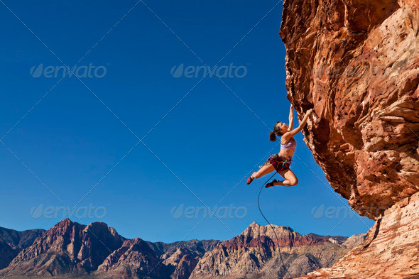 Stock Photo - PhotoDune Dangling Rock Climber 551926