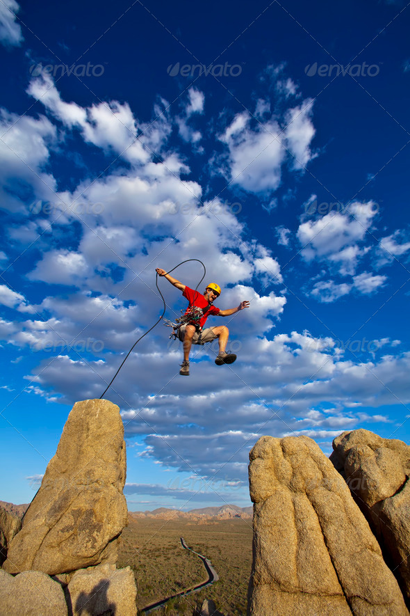 Stock Photo - PhotoDune Leaping Rock Climber 551927