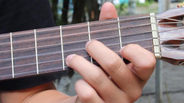 Playing At Guitar 5