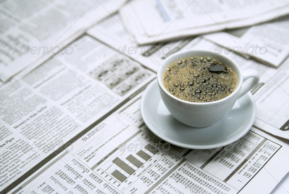 Coffee over newspaper - Stock Photo - Images