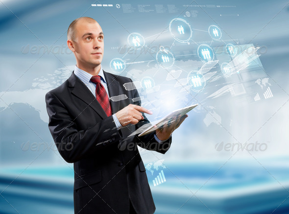 Businessman with tablet pc - Stock Photo - Images