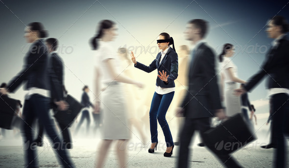 Businesswoman in blindfold among group of people - Stock Photo - Images