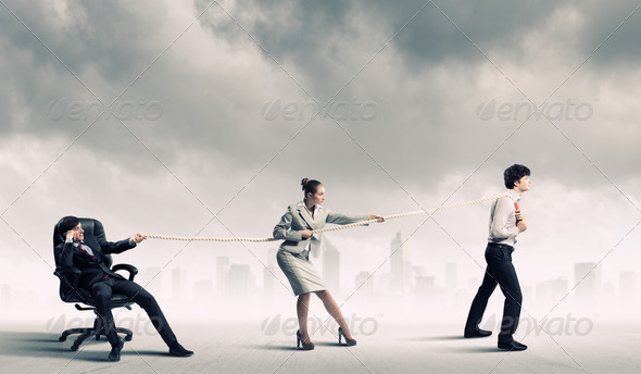 Three business people pulling rope - Stock Photo - Images