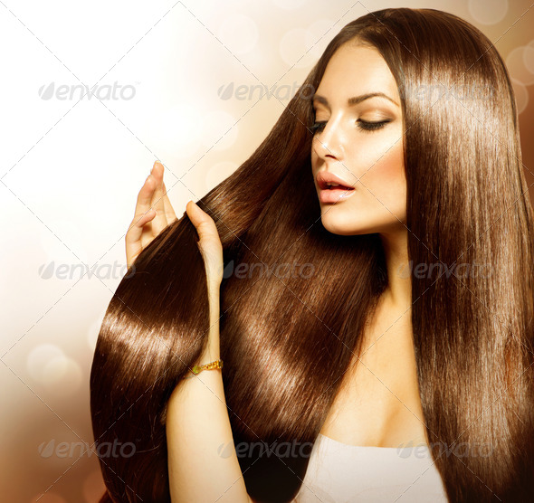 Beauty Woman touching her Long and Healthy Brown Hair - Stock Photo - Images