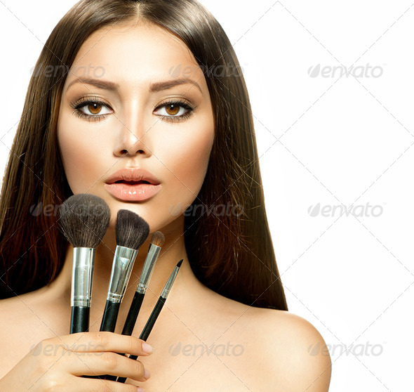 Beauty Girl with Makeup Brushes. Make-up for Brunette Woman - Stock Photo - Images