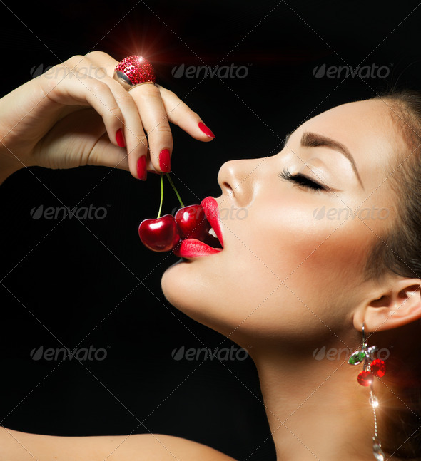 Sexy Woman Eating Cherry. Sensual red Lips with Cherries - Stock Photo - Images