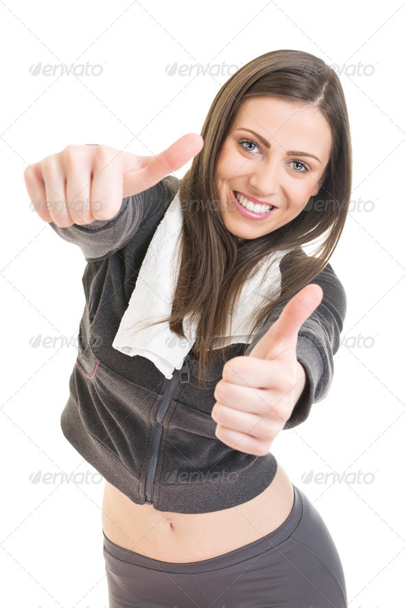 Cute fitness girl expressing positivity showing thumbs up - Stock Photo - Images