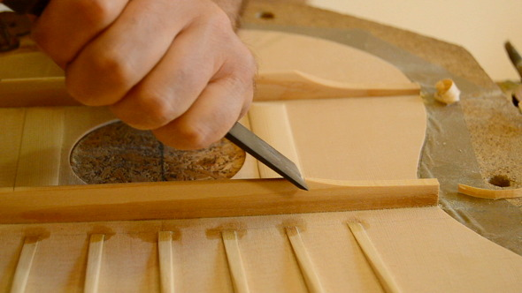 Luthier Working With a Chisel