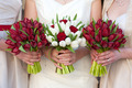 red and white tulip and rose wedding bouquets