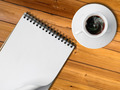 Notebook and White cup of hot coffee - PhotoDune Item for Sale