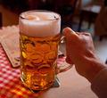 Liter glass of beer in hand