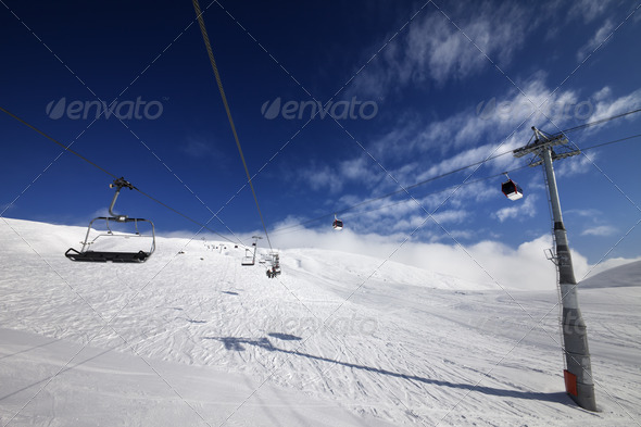 Gondola and chair lift at nice sunny day - Stock Photo - Images