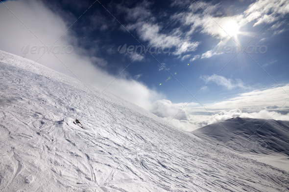Off-piste ski slope and blue sky with sun - Stock Photo - Images