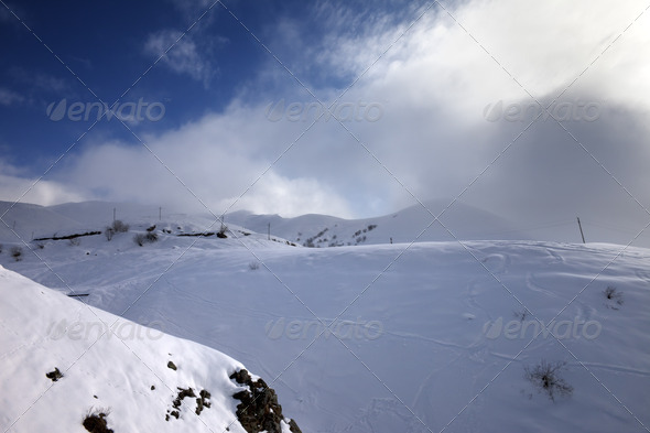 Off-piste slope and mountains in haze - Stock Photo - Images