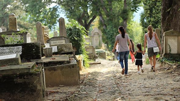 Little Girl Walking in Cemetery