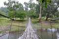 rope bridge over the river - PhotoDune Item for Sale
