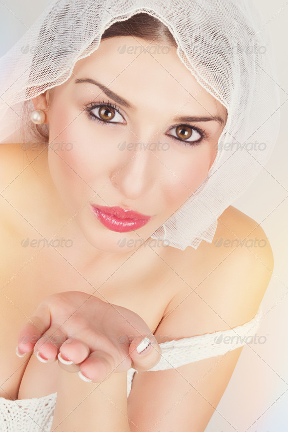 Happy bride sending a kiss - Stock Photo - Images