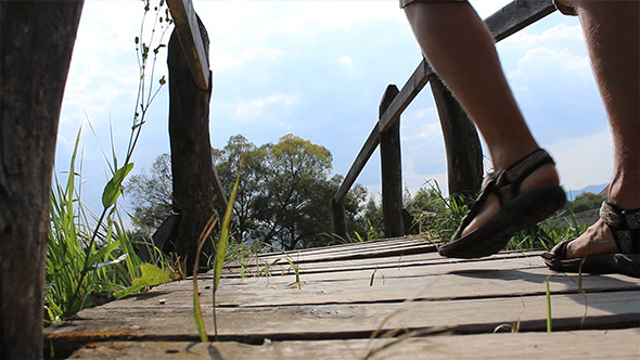 VideoHive Passing A Wooden Footbridge 5474806
