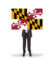 Smiling businessman holding a big card, flag of Maryland - PhotoDune Item for Sale