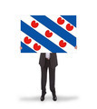 Smiling businessman holding a big card, flag of the dutch provin - PhotoDune Item for Sale