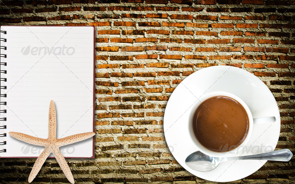 Coffee Cup and Notebook on the wall. - Stock Photo - Images