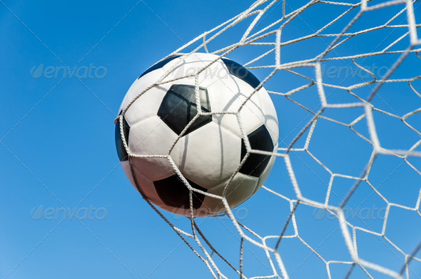 Soccer Ball in Goal Net. - Stock Photo - Images