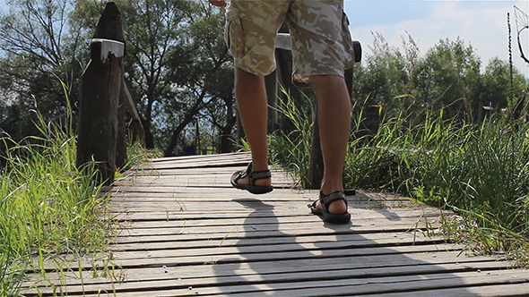 VideoHive Man Steps Across a Footbridge 5511794