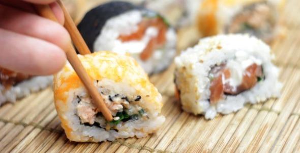 Eating Japanese Sushi Rolls