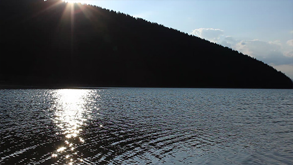 VideoHive Sun Reflections on Lake Surface 5527317
