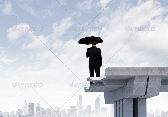Businessman on bridge - Stock Photo - Images
