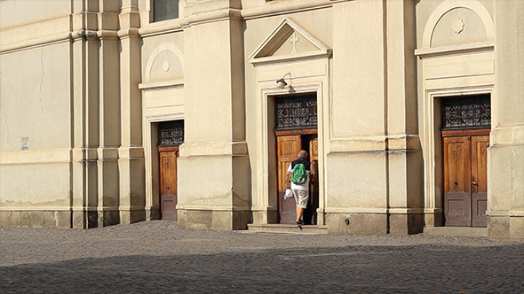 VideoHive Man with Bagpack Enters Church 5527510