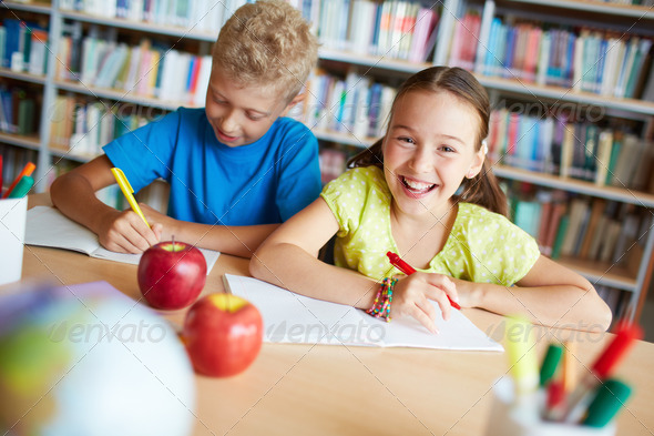 Classmates in library - Stock Photo - Images