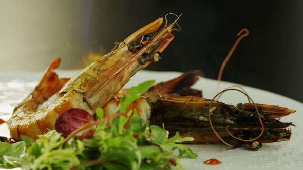 VideoHive Chef Preparing Seafood Dish with Fried Prawns 5530972